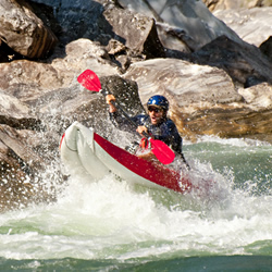 Canyons Duckie catching air in a rapid on the Salmon river
