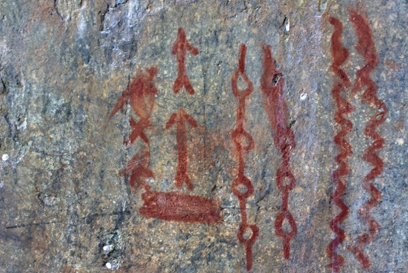 Human history pictographs painted on the rock face